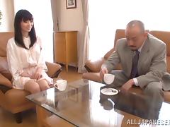 An older guy fucks a sexy Japanese girl on the couch