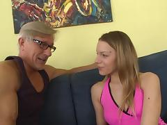 A younger chick gives an older guy a footjob before taking it in the ass