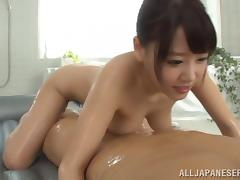 Curvy Asian babe with oiled natural tits riding huge dick hardcore while moaning