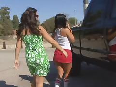 Brunette lesbian in miniskirt smashing her babe pussy using massive strap on