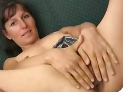 Tiny hairy mature toying her pussy