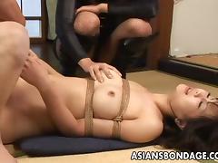 Beautiful Asian babe in bondage riding big cock hardcore while moaning