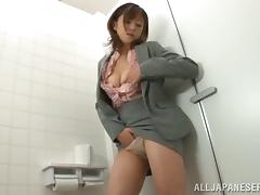 Foxy Japanese cowgirl fingers her pussy while masturbating in the toilet