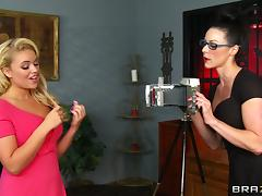 Beautiful lesbian in glasses getting the pleasure of huge strapon in closeup shoot