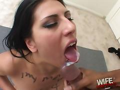 Kinky brunette babe swallows cum after getting her face fucked in a spicy interracial action