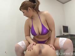 Chubby Asian babe in a bikini giving an endearing tit fuck