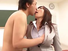 Lewd Japanese teacher enjoys doggystyle anal sex at her work place