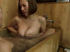 Enchanting Japanese cowgirl with big tits giving a tit job in the bath tub