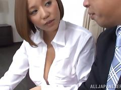 Horny Japanese couple fucking doggy style on a couch
