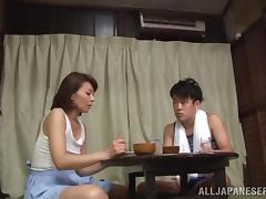 After a nice dinner this Japanese girls sits on a guy's cock