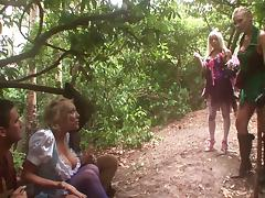 Wild blonde with huge tits enjoying a hardcore gangbang in a forest