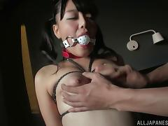 Hot Asian in bondage engaging in BDSM sex