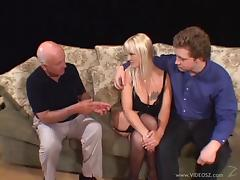 Horny cougar gets fucked in the presence of two voyeurs