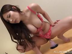 A naughty Japanese MILF satisfies her needs with a big vibrator