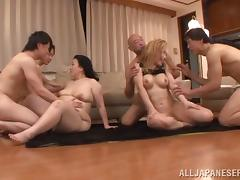 Two crazy Japanese sluts get fucked in a group sex party