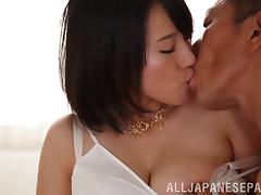 Watch her big Japanese tits bounce around as he fucks her