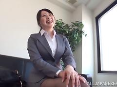 A pretty Japanese businesswoman gets her pussy toyed in the office