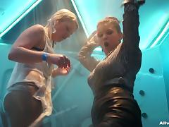 Hot girls kissing and dancing in a shower on a club stage