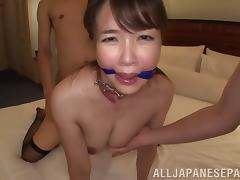 Japanese slut in a collar acts like a good sex slave for them