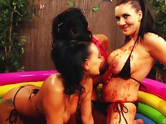 A threesome of red hot sluts getting messy in pool