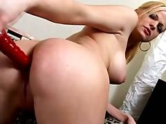 Kinky cougar with big tits playing with her shaved pussy on her sofa