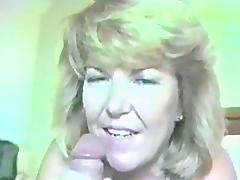 A cock craving cougar gives a cute blowjob and swallows cum in a close up scene