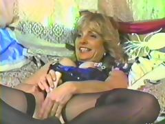A naughty MILF uses some toys on her big tits and hairy pussy