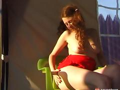 Pleasing her sweet muff in a tent as the sun goes down