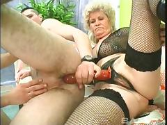 Horny granny fucks two studs hardcore in a kinky threesome