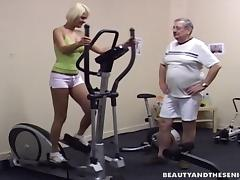 A horny hot blonde fucks an older fat guy at the gym