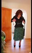 Sindy swishing herskirt & opening her blouse