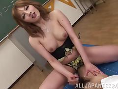 Dynamic Japanese teacher enjoys a wild mmf threesome at work