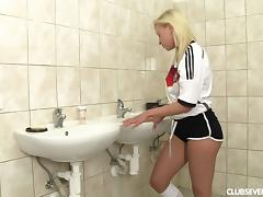 German sports lady sneaks to the toilet to quench her urge for a steamy masturbation