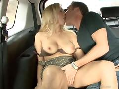 Blonde babe with huge natural tits enjoying a hardcore fuck in a car