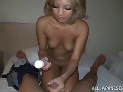Tiny tits Asian beauty jerks a cock until she gets covered with jizz