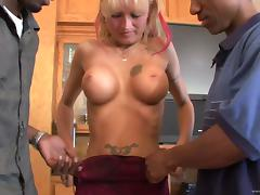 Blonde cougar with big fake tits enjoying an interracial threesome