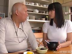 Pretty Asian chick with big boobs sucking an old man's cock