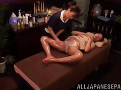 Alluring Asian lesbian enjoys an oily massage with a happy ending