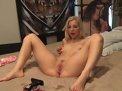 Honry blonde teases her clit with a toy during fucking