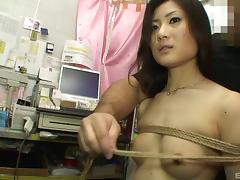 Bound Asian taken to the adult shop and fucked by a dildo