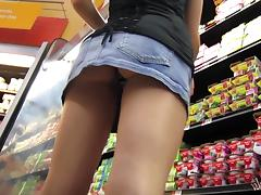 Filming her juicy booty while she walks around the supermarket