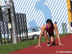 A hot track star finishes her workout by fucking her hairy pussy