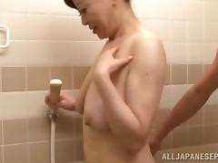 Sexy Japanese mature woman receives company while showering