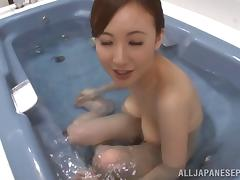 After soaping up her hairy honey hole he fucks her tits in the tub