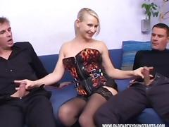 Stocking-clad whore with a shaved pussy enjoying a hardcore threesome