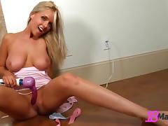 Blonde stunner tries her new vibrator in epic solo shoot