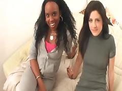 Two total hotties share a double dildo in an interracial lesbian video