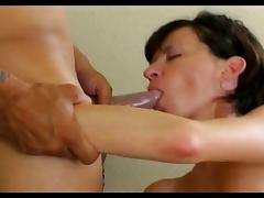 Hot brunette MILF spreads her pretty pink pussy then fucks with two guys
