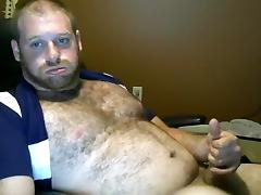 Comely poof is jerking off in the guest room and shooting himself on camera