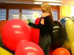 Sexy girl massacres huge balloons part 1